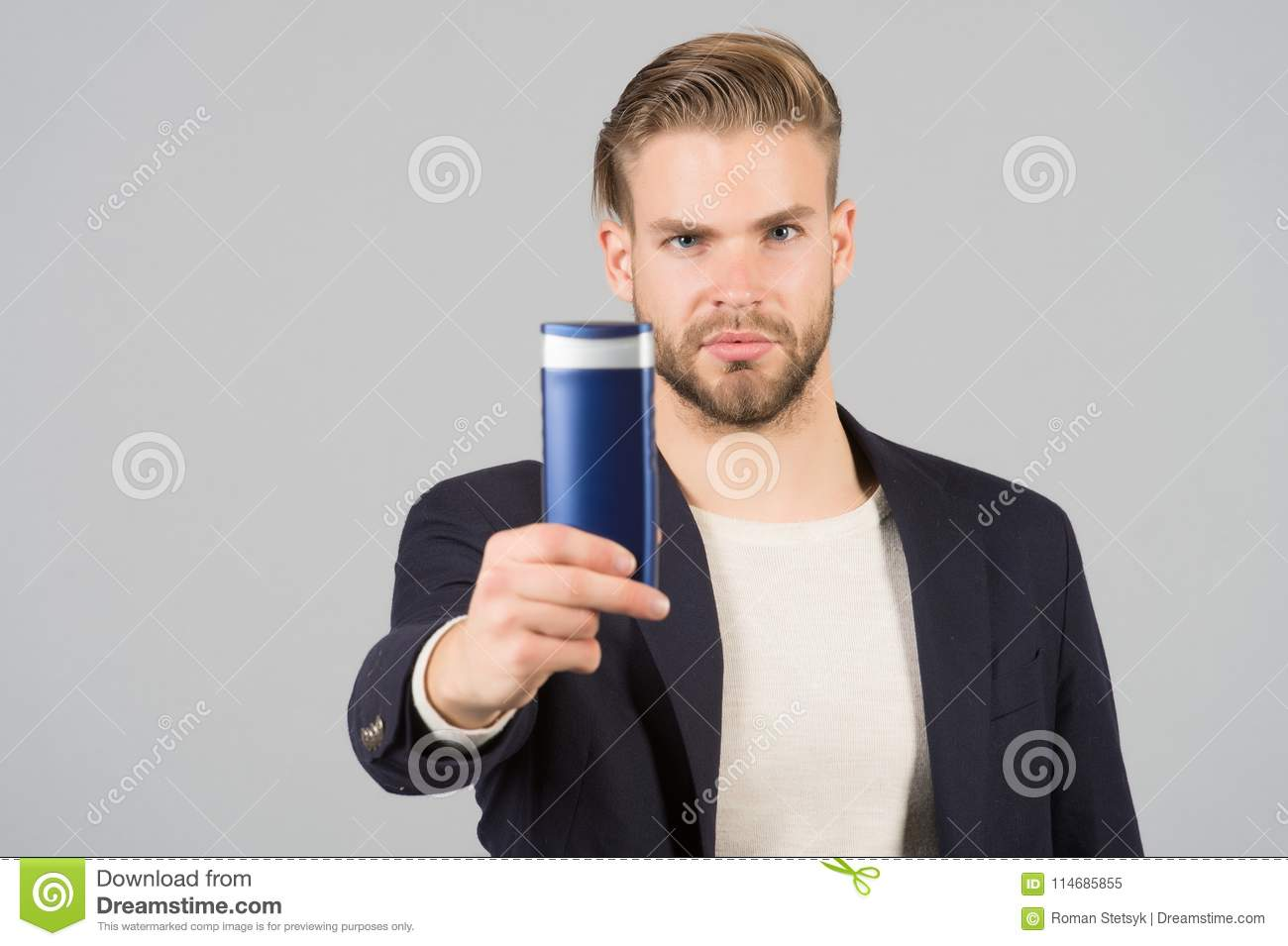 Businessman With Shampoo Or Gel Bottle In Hand Bearded Man With