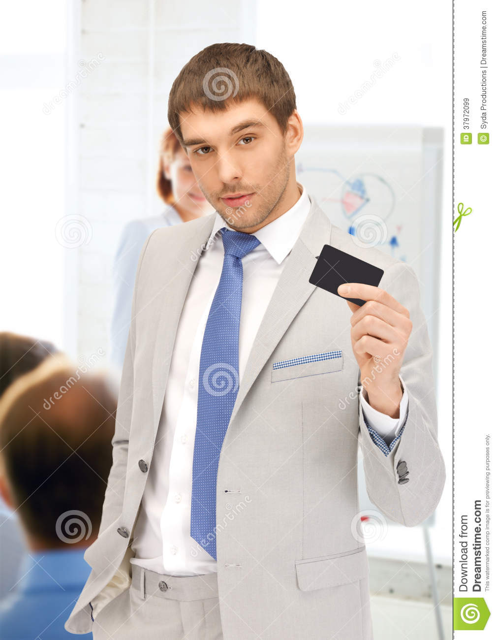 Businessman Showing Credit Card In Office Royalty Free ...