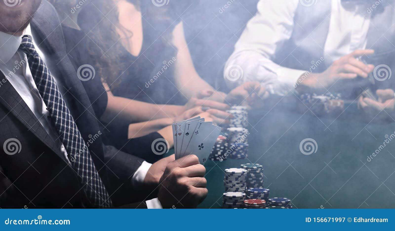 Businessman showing four aces