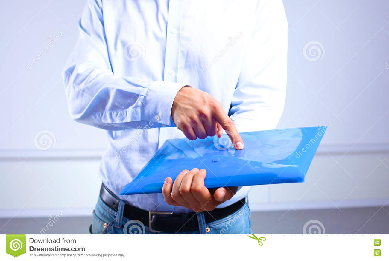 Businessman showing an important document in the folder