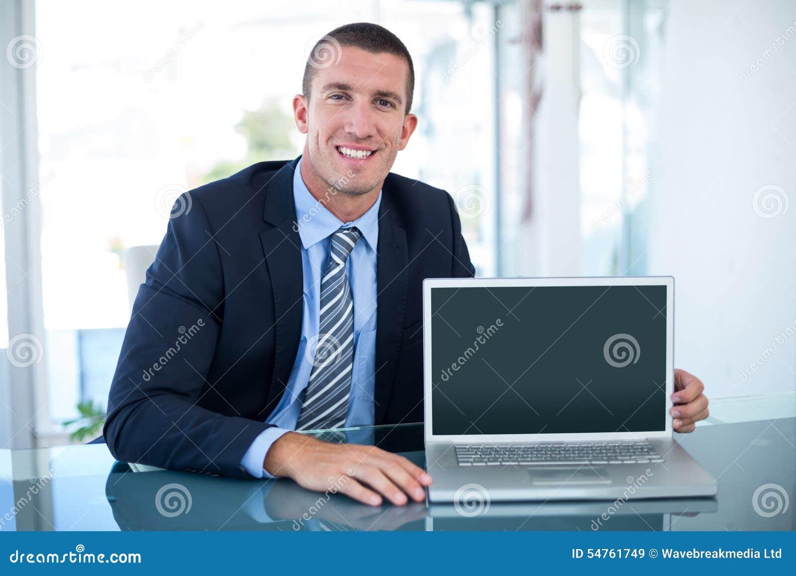 Businessman showing laptop