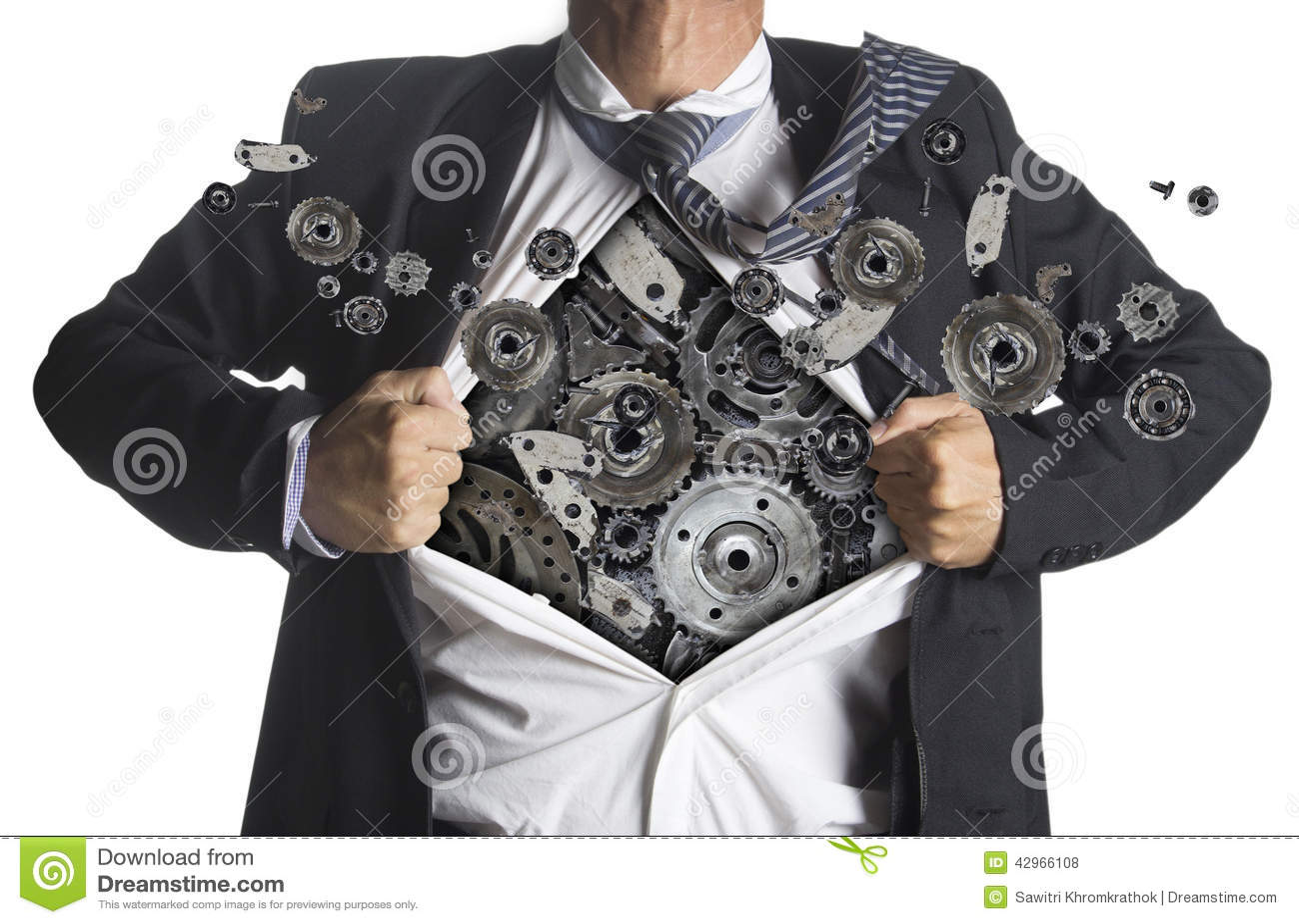 Businessman showing a superhero suit underneath machinery
