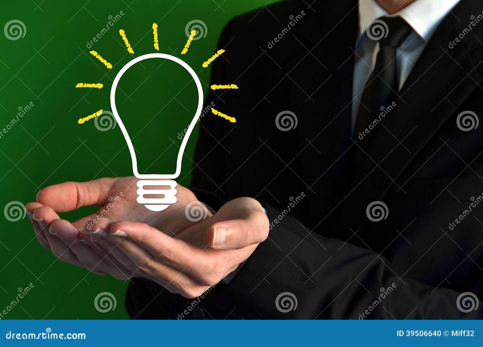 Businessman showing a virtual bulb symbol
