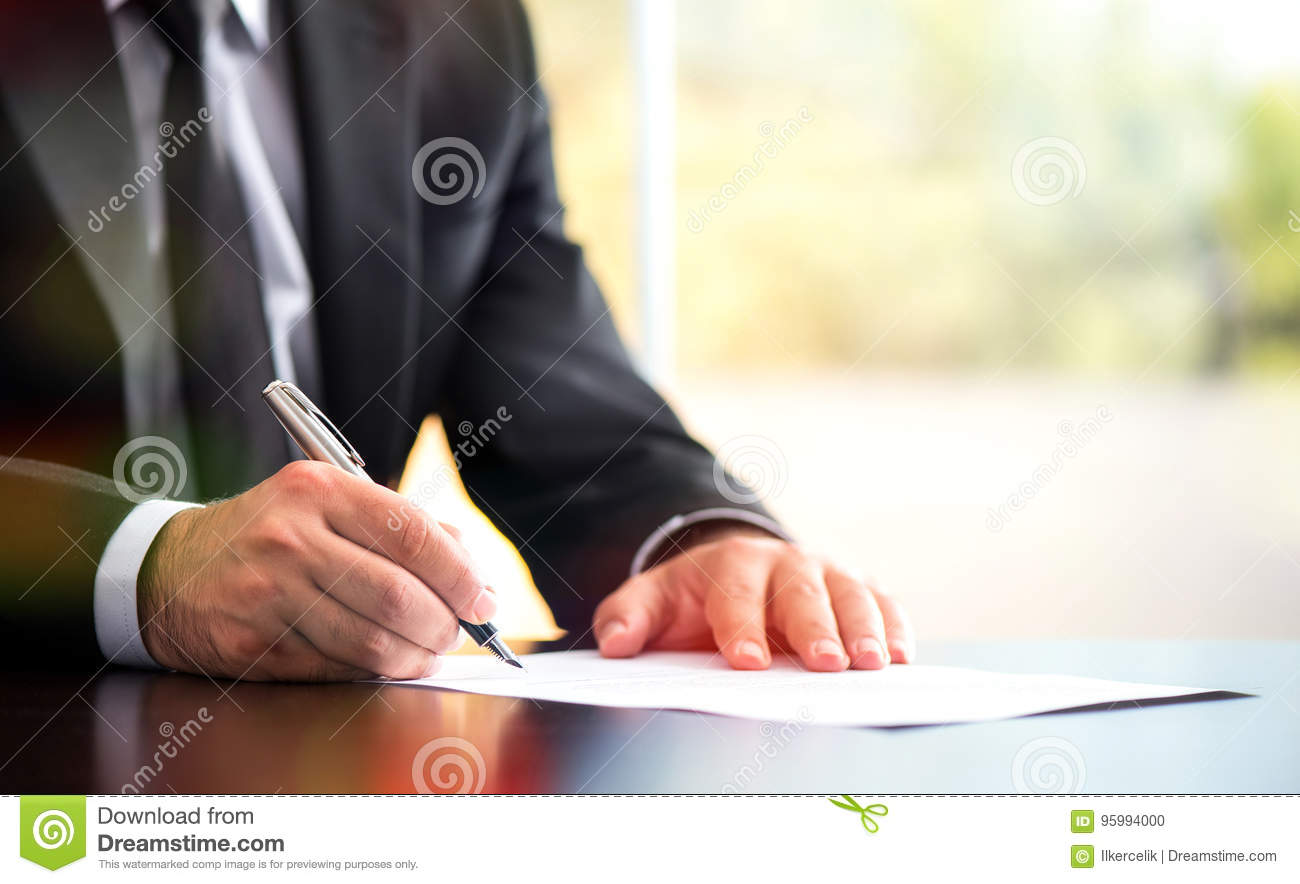 Businessman Is Signing A Legal Document Stock Photo Image Of Desk - Signing legal documents