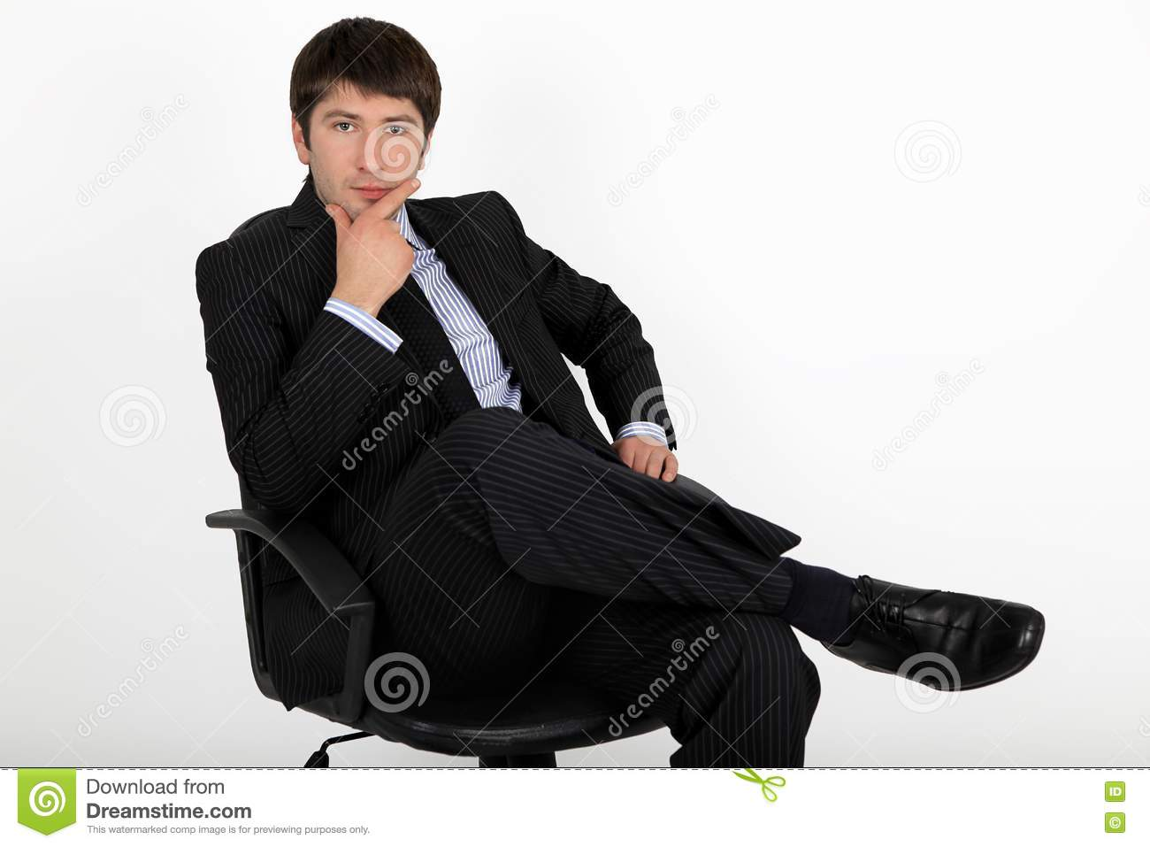 Businessman sitting in an armchair royalty free stock for Sitting in armchair