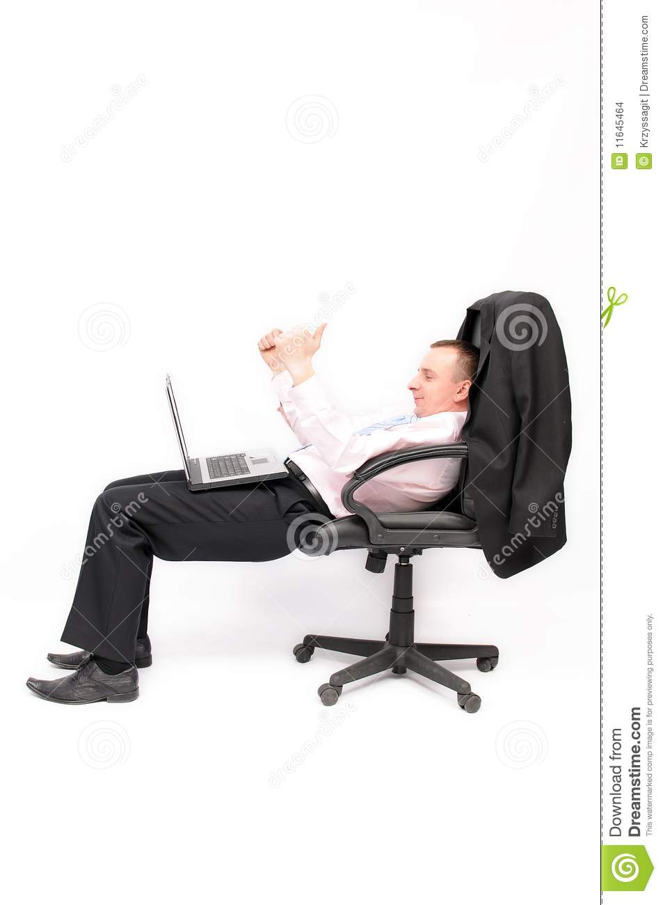Businessman sitting in an armchair with a laptop stock for Sitting in armchair