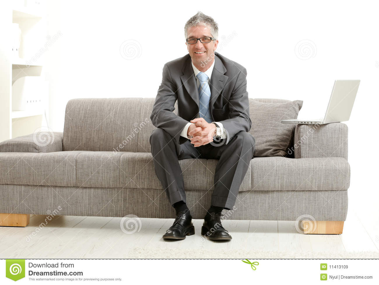 businessman sitting on couch royalty free stock images. Black Bedroom Furniture Sets. Home Design Ideas