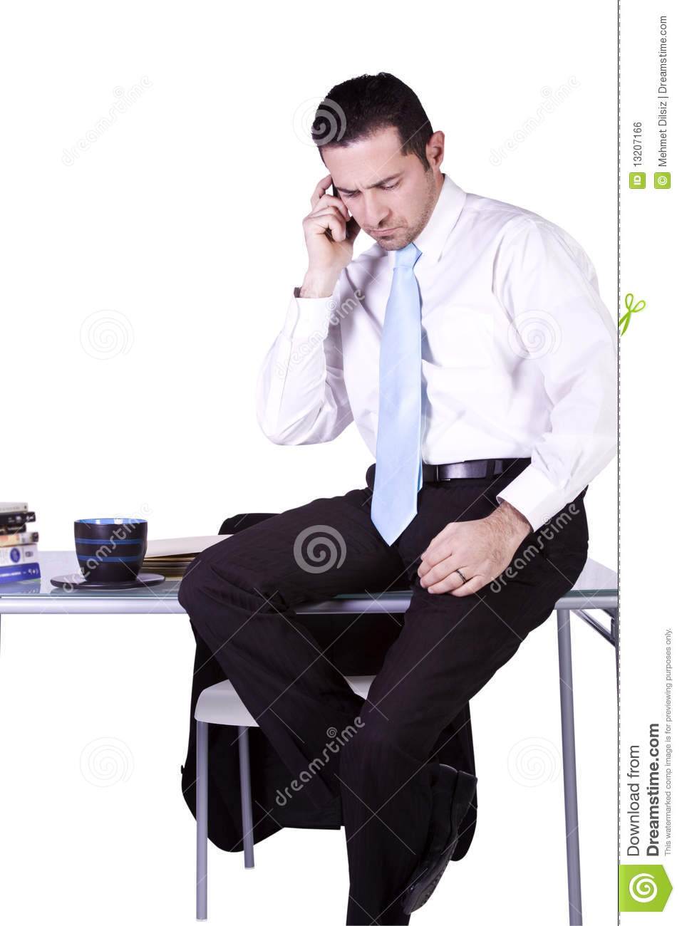 Businessman Sitting At His Desk