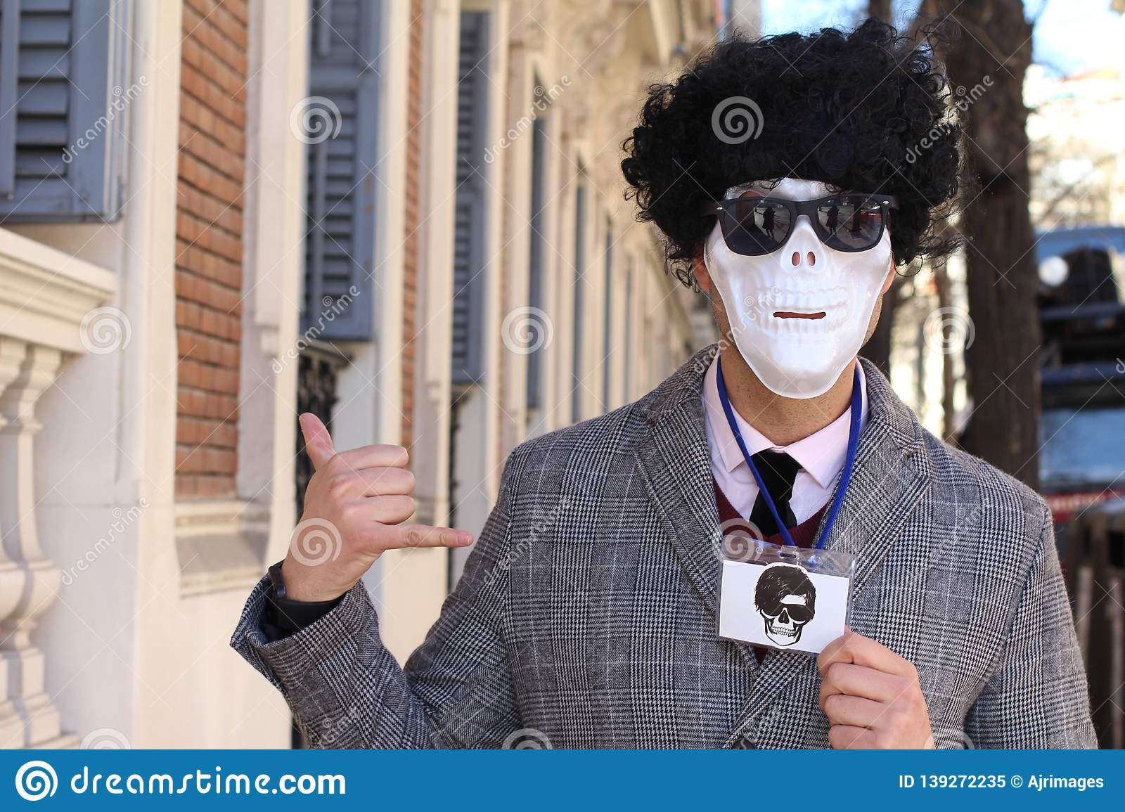 Businessman with skeleton face showing ID batch