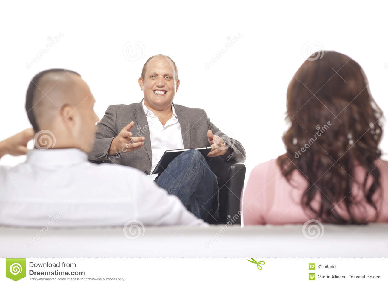 Businessman Smiling In Front Of Two Colleague