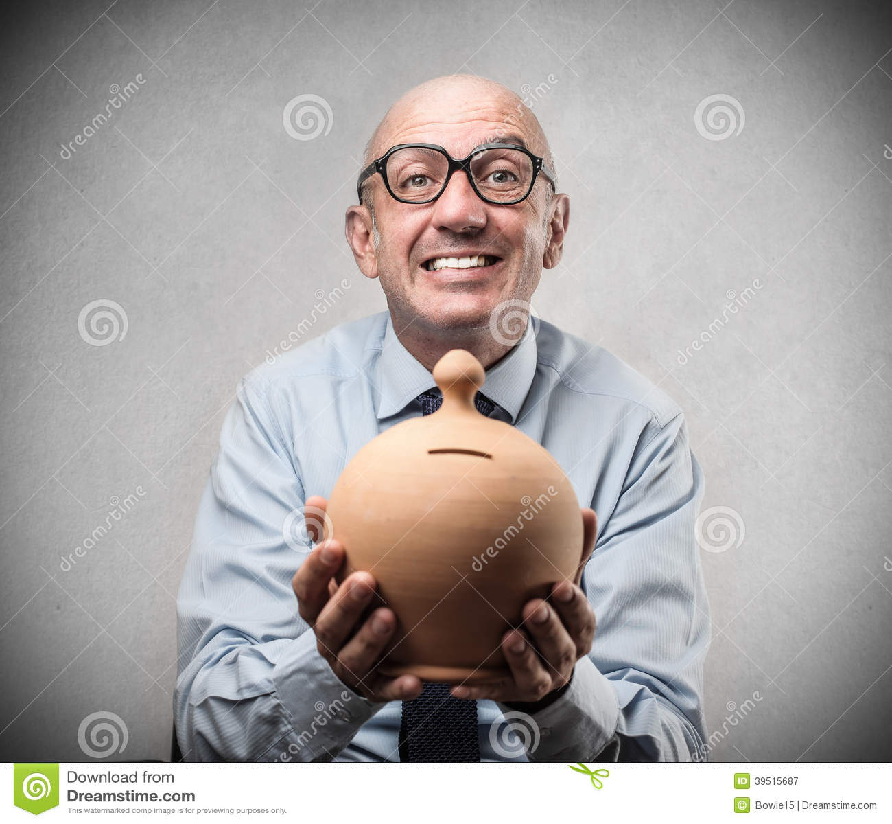 Businessman smiling and holding a piggy-bank