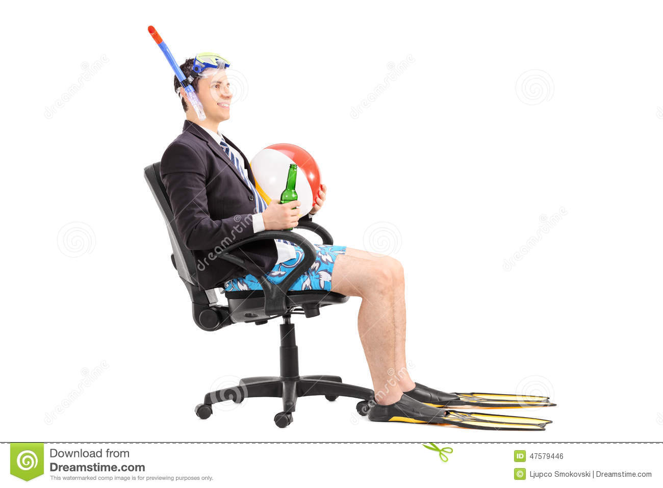 Businessman with snorkel sitting in an office chair