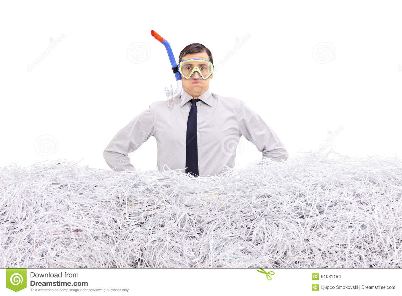 Businessman with snorkel standing in shredded paper