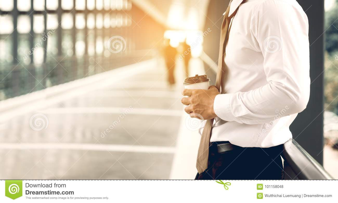 Businessman standing at building walkway company with hope concept.