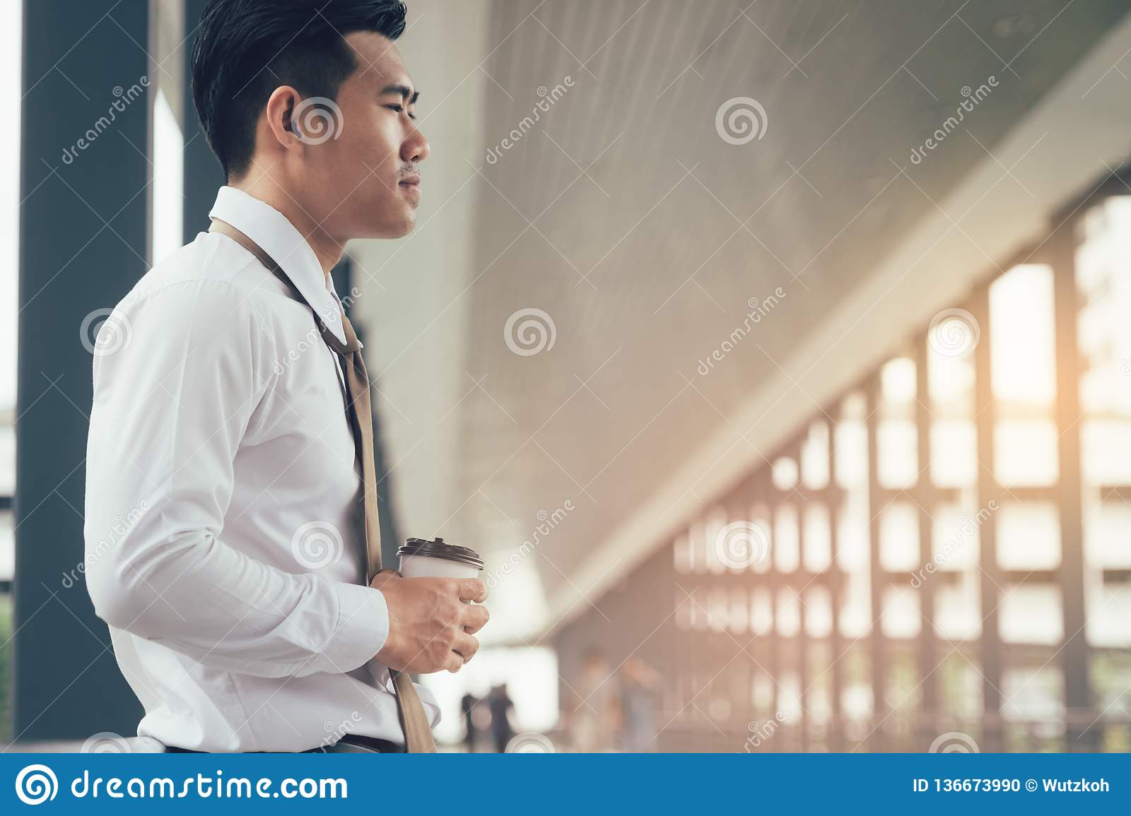 Businessman standing at building walkway company with hope concept