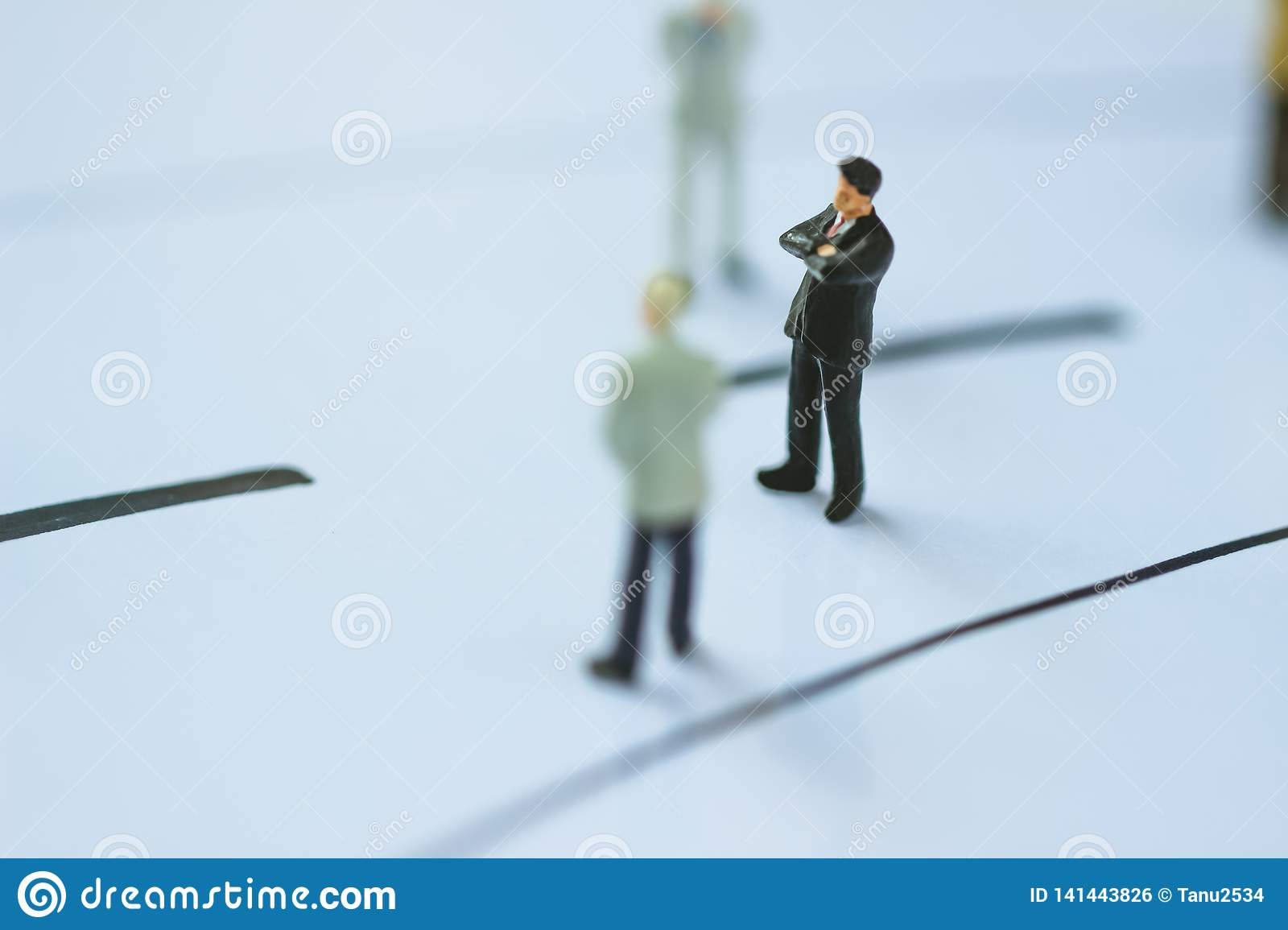 Businessman standing on the business line