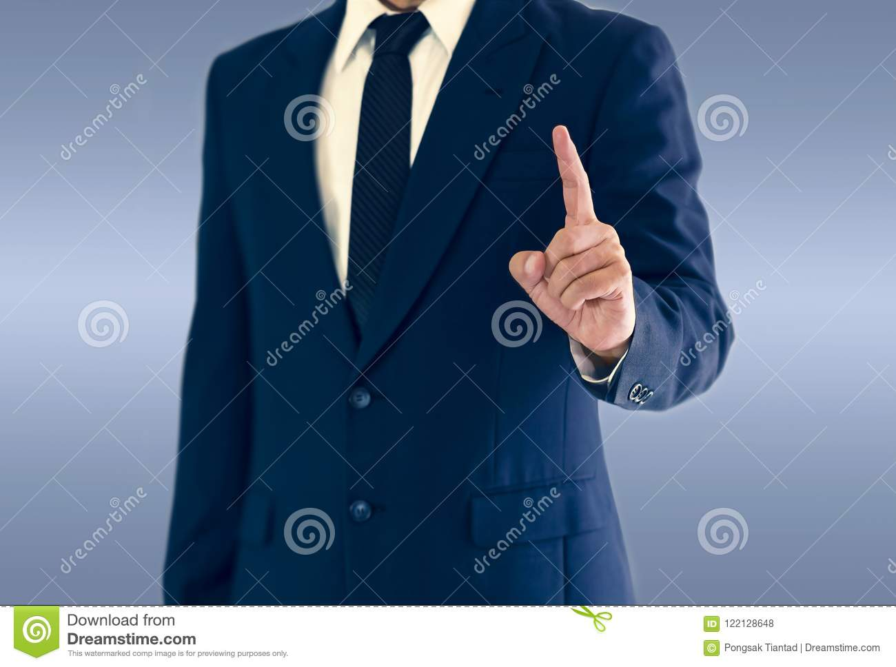 A businessman is standing and pointing hand.
