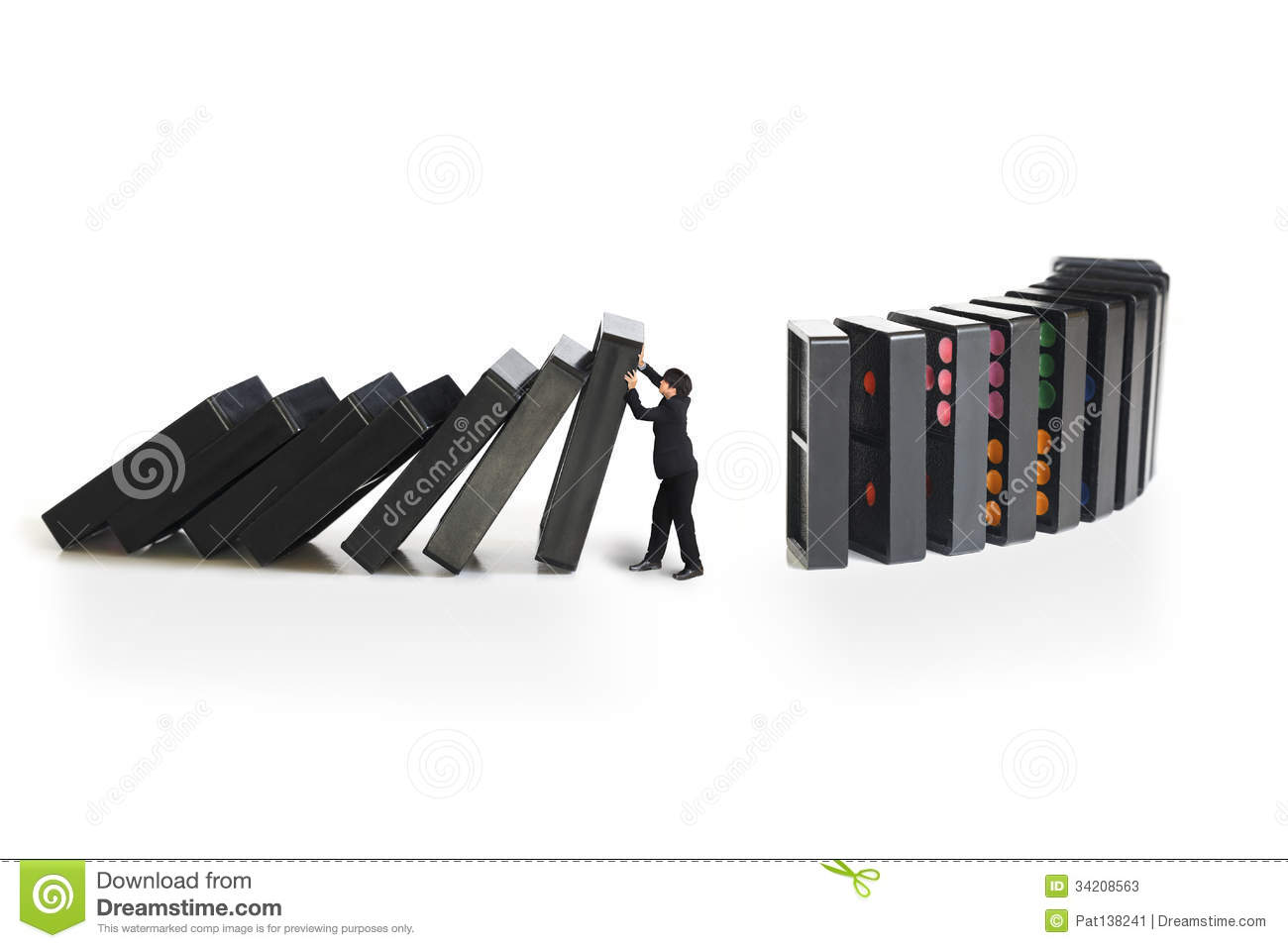 stop domino effect stock photos images pictures images businessman stopping the domino effect stock photos