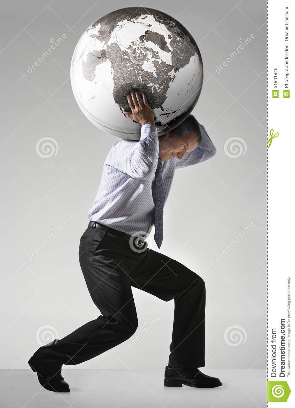 businessman struggling to carry globe on shoulders stock image