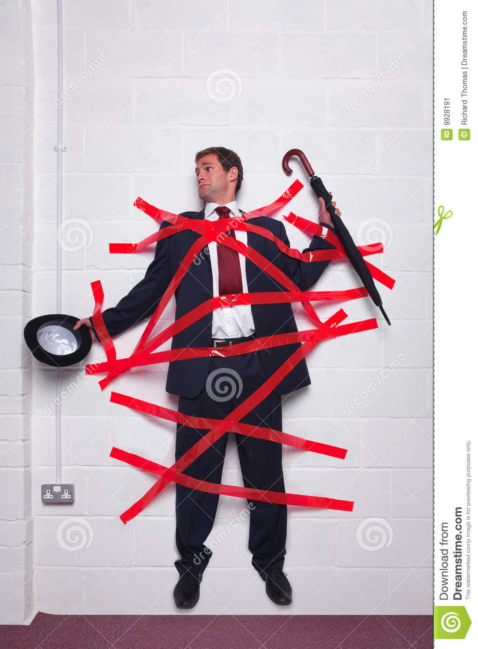 Businessman Stuck To Wall With Red Tape Royalty-Free Stock ...