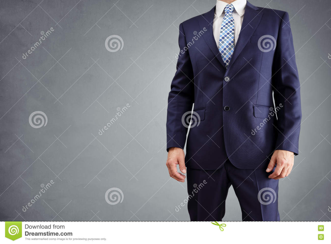 Businessman in a suit isolated on gray background