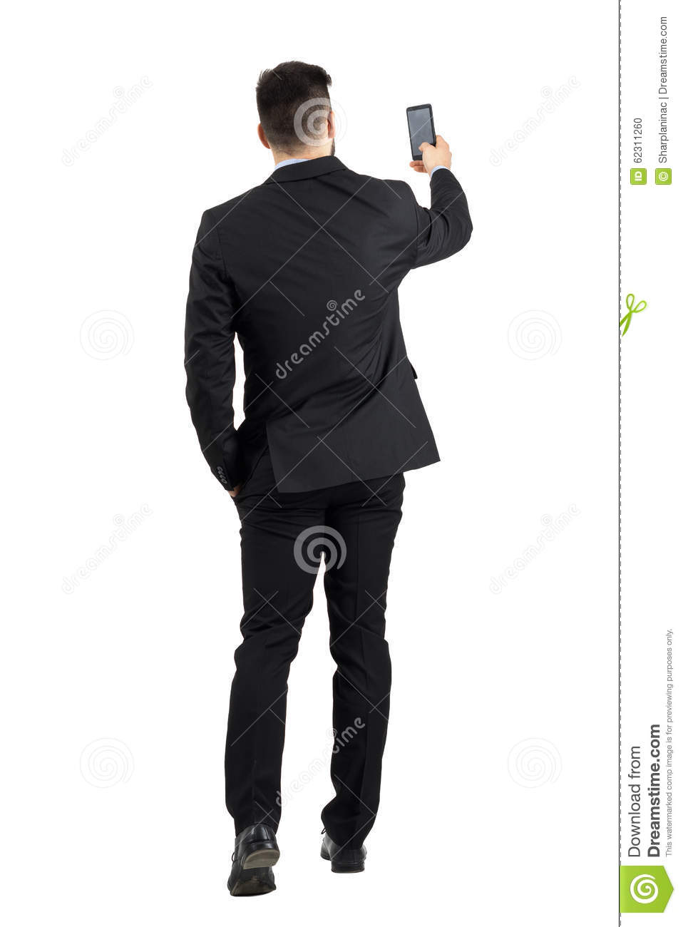 ddc3dbad42d Businessman in suit searching for good phone signal rear view or taking  photo. Full body length portrait isolated over white studio background.