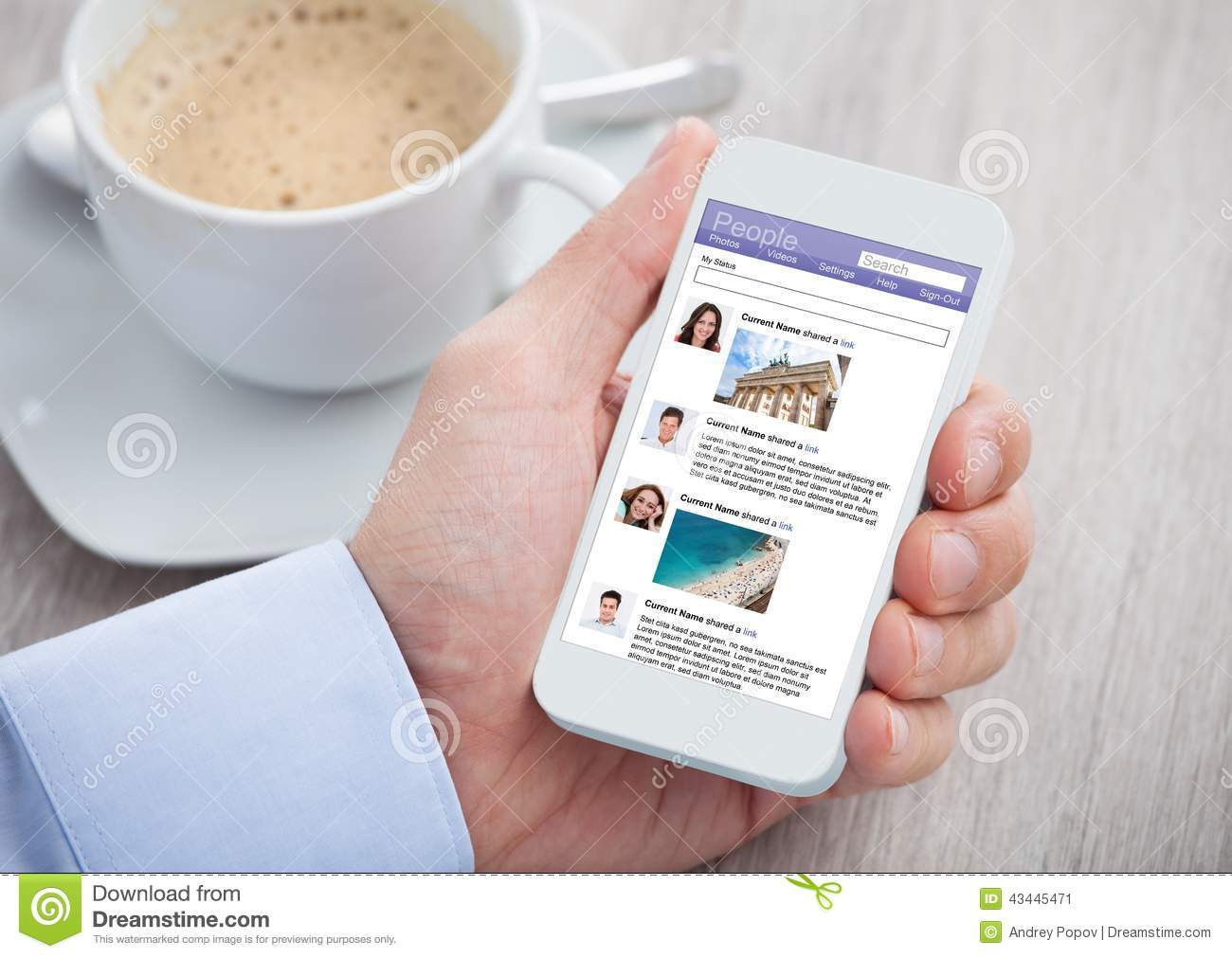 Businessman surfing social networking site on mobilephone