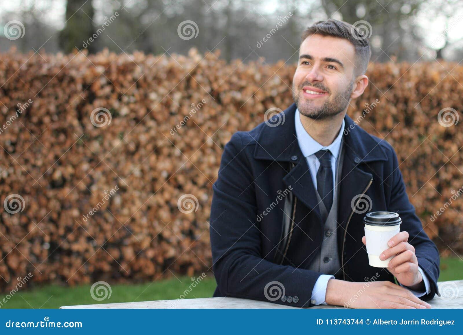 Take Break Coffeebreak : Businessman taking a coffee break stock photo image of jacket