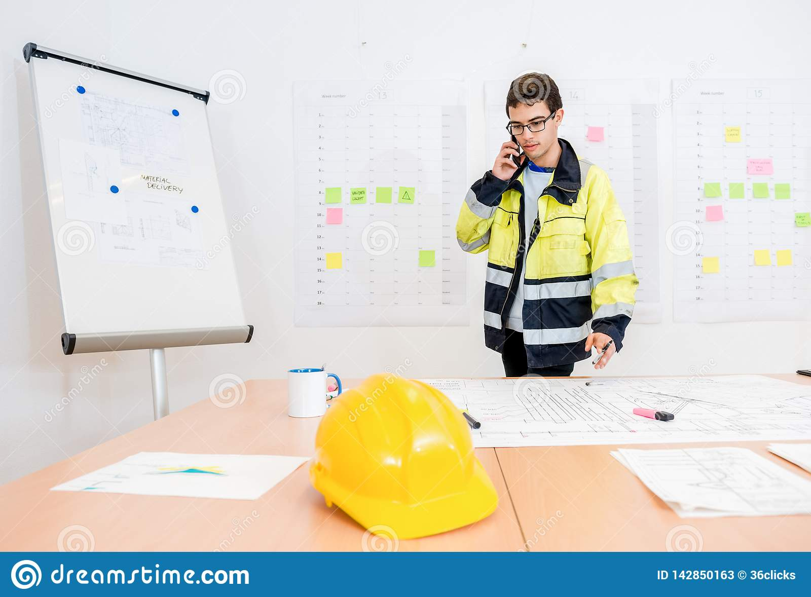 Businessman Talking On Mobile Phone At Office Table