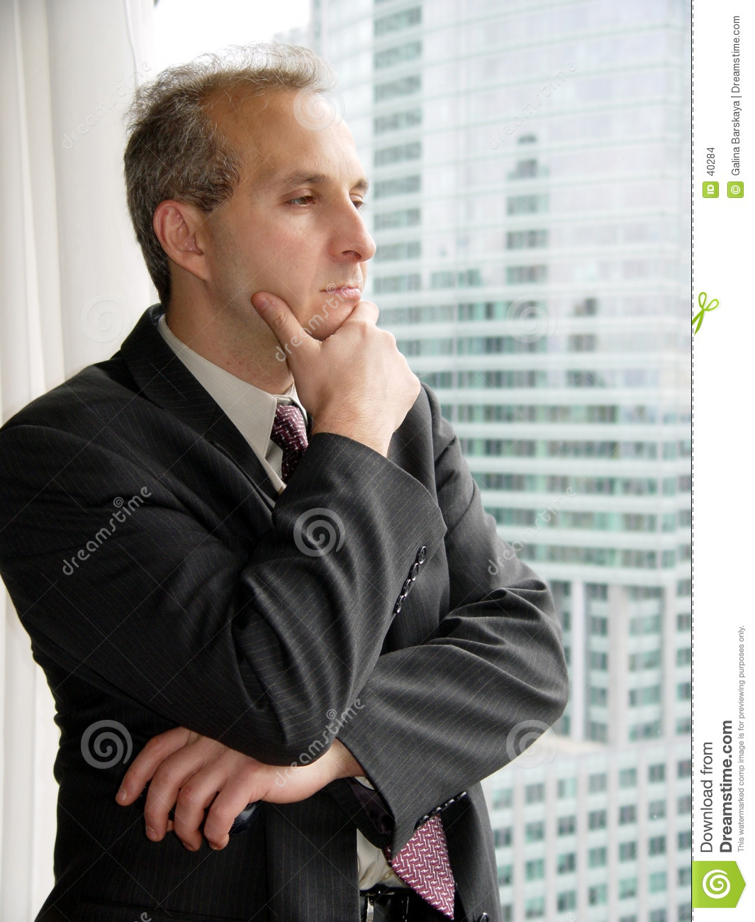 Businessman thinking by the window