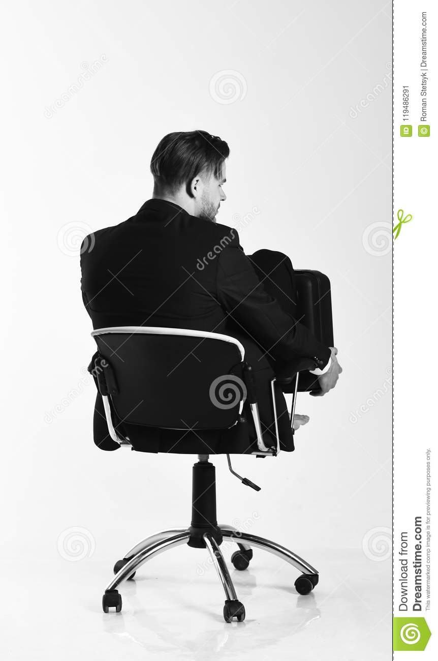 Businessman thinks about solutions isolated on white background. Man in smart suit looks for new ideas.