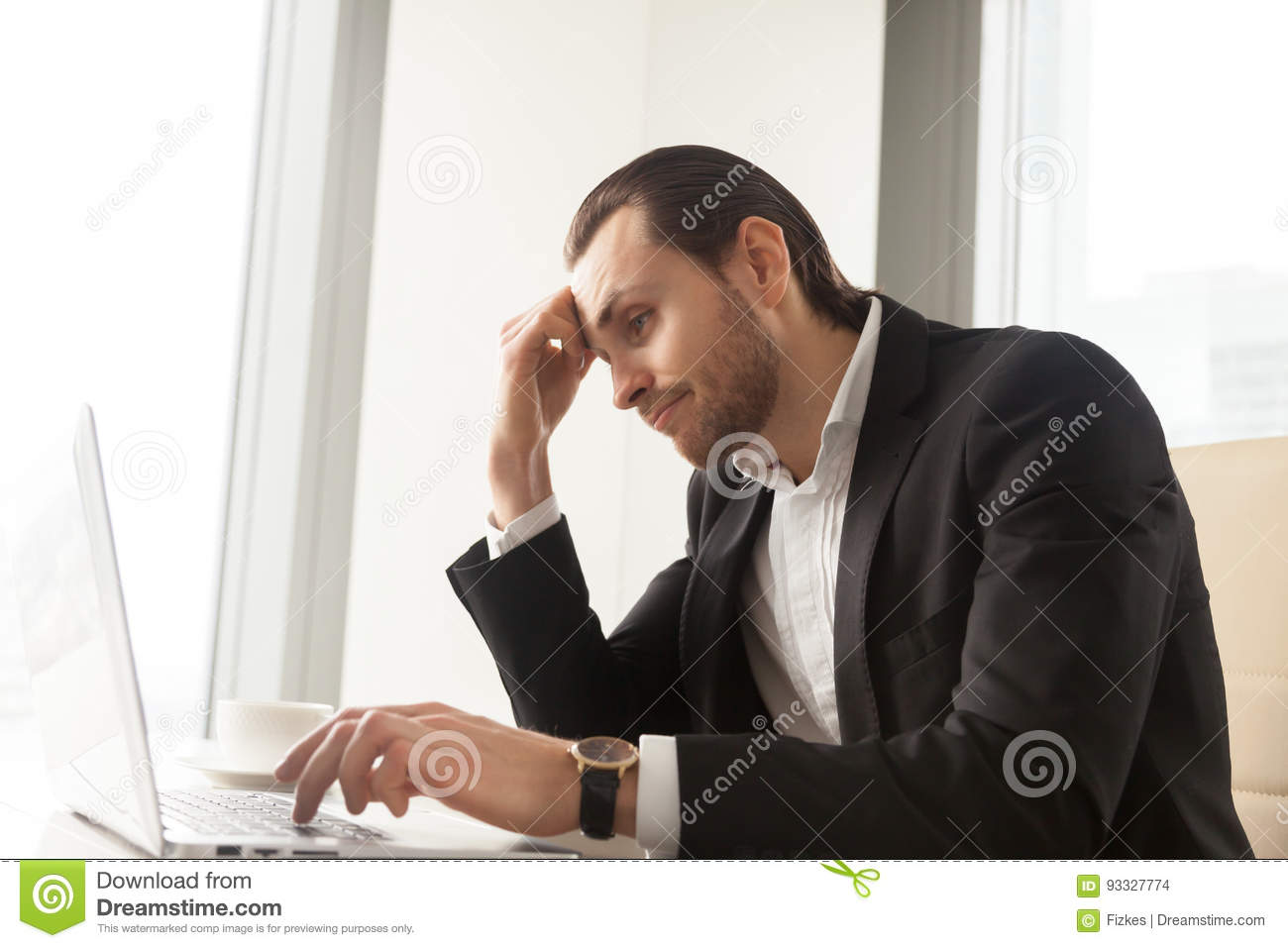 Businessman tired from routine work on laptop