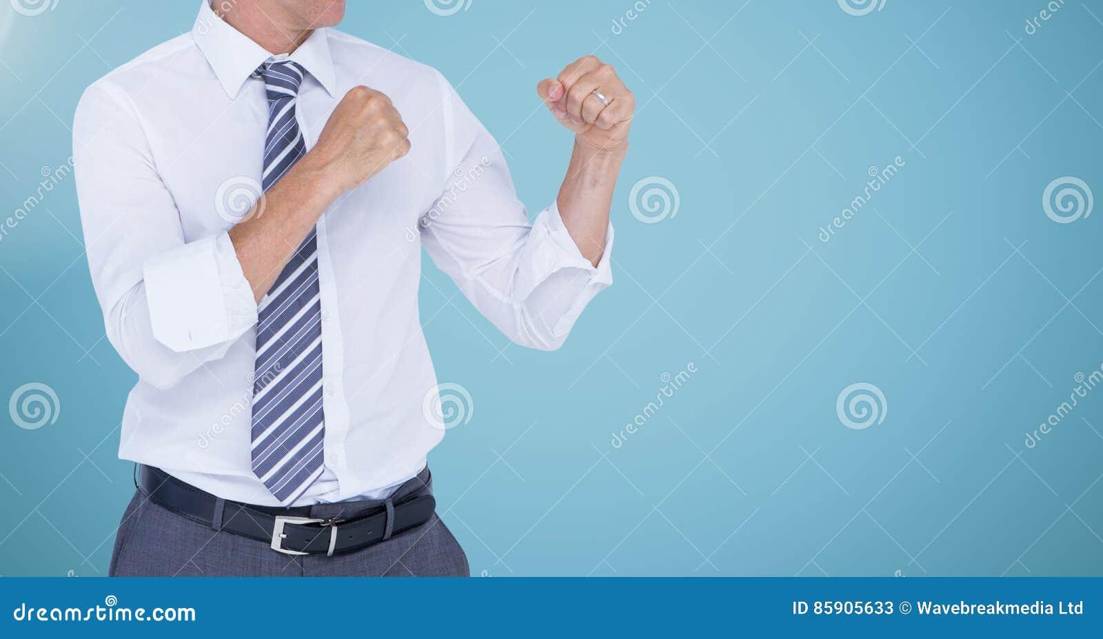 Businessman Torso with combative posture against neutral blue background