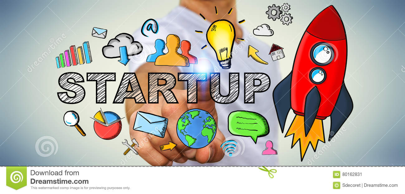 Businessman Touching Hand Drawn Startup Text And Red Rocket