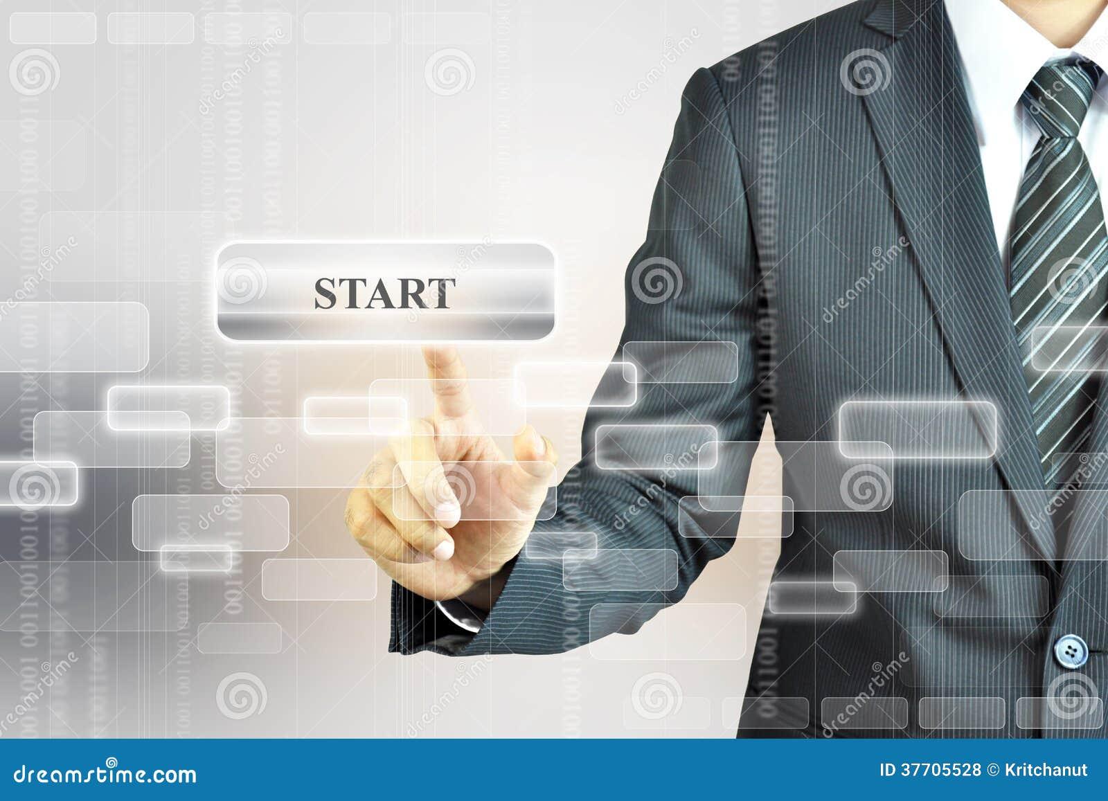 Businessman touching START button on virtual screen