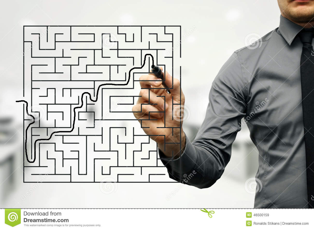 businessman trying to find way out of maze