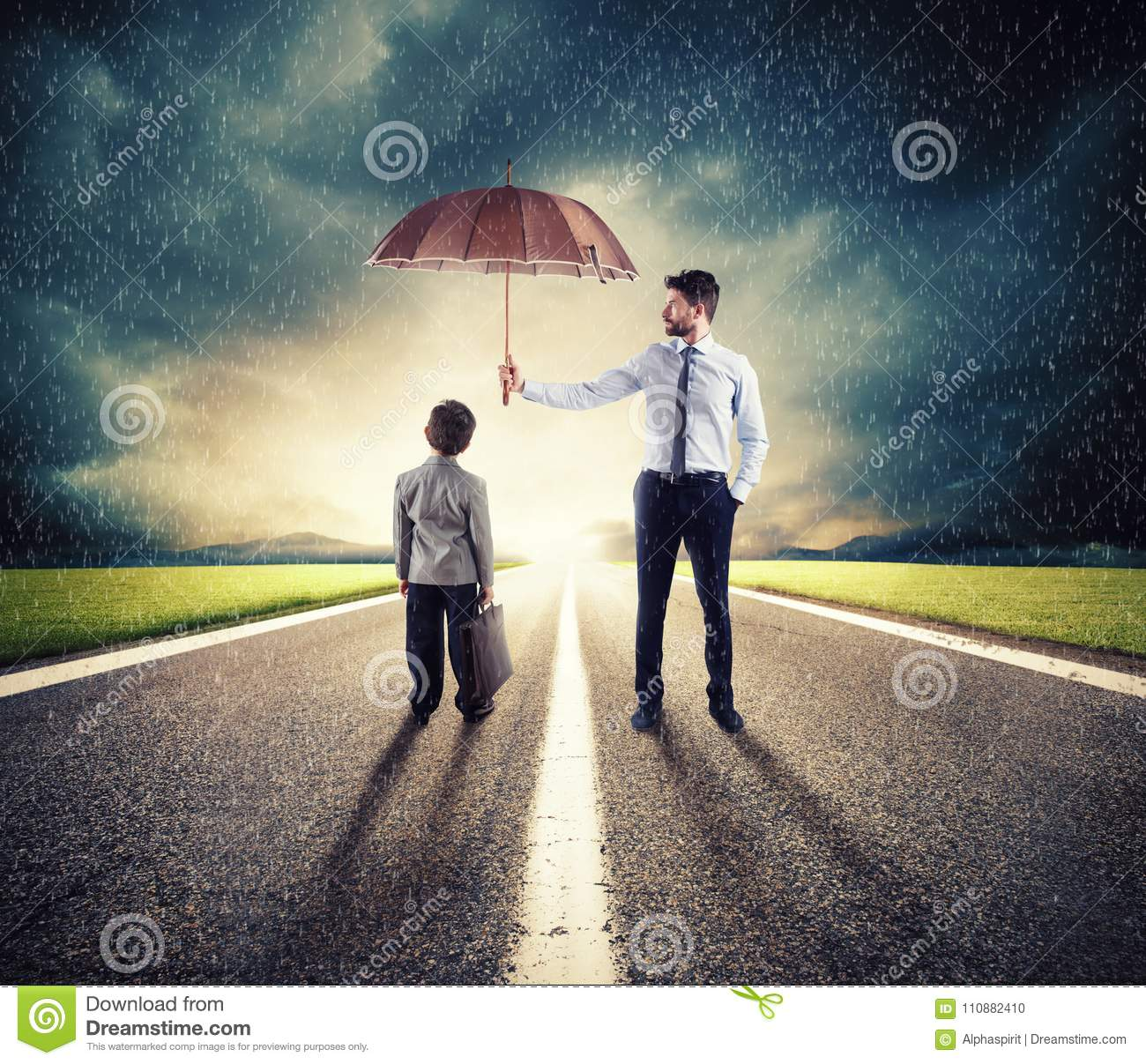 Businessman with umbrella that protect a child. Concept of young economy and startup protection