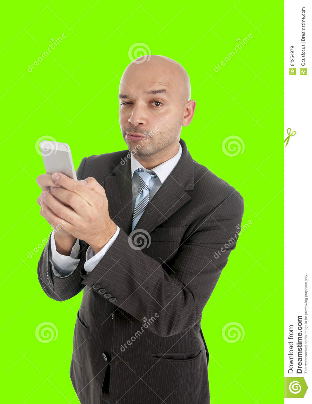 Businessman using compulsively cell phone smiling in mobile addiction isolated green chroma key
