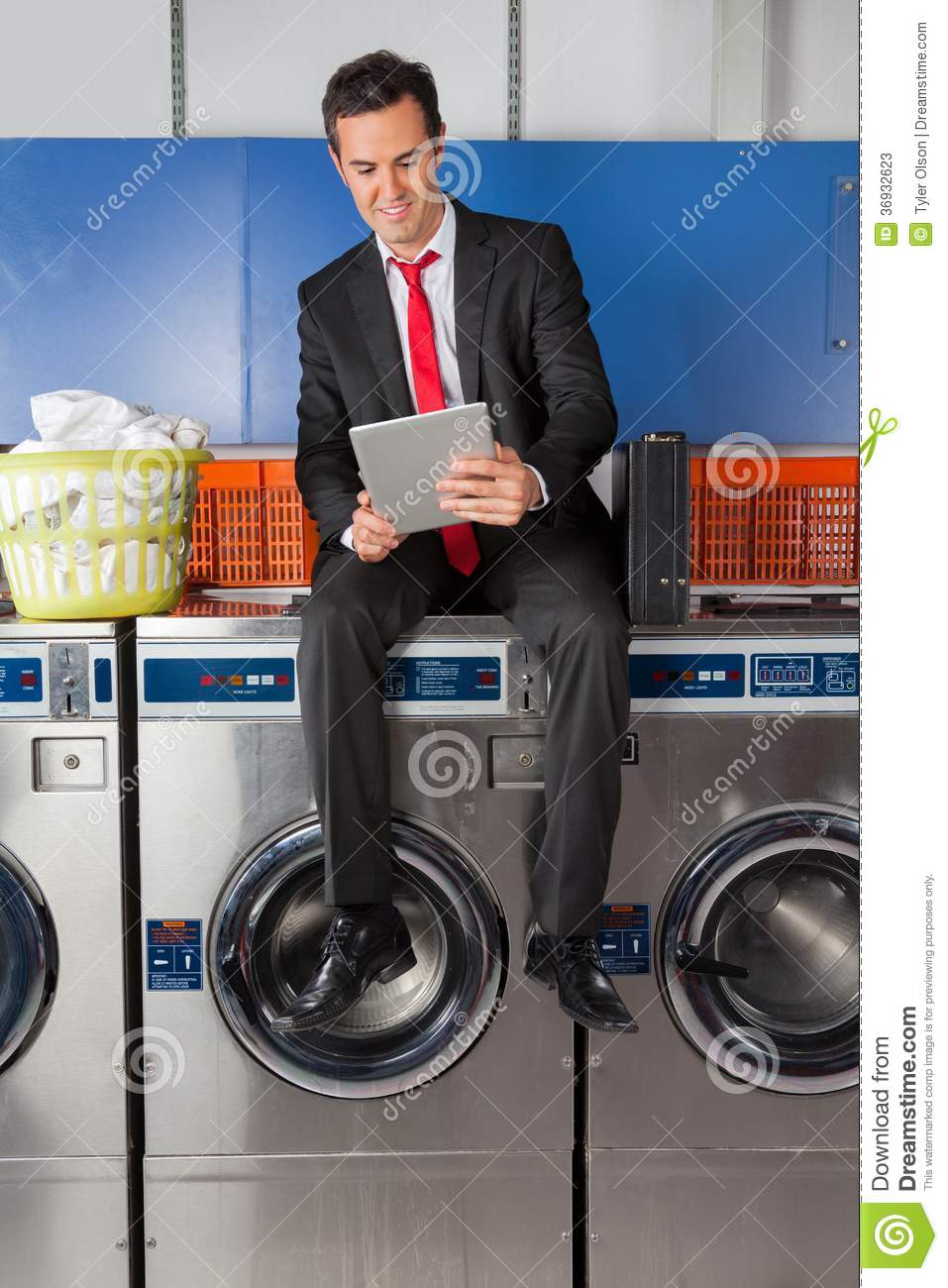 Businessman Using Digital Tablet In Laundry