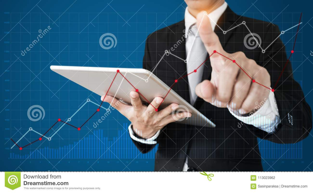 Businessman using digital tablet and pointing finger on graph diagram. Break even point, business growth, investment and finance c