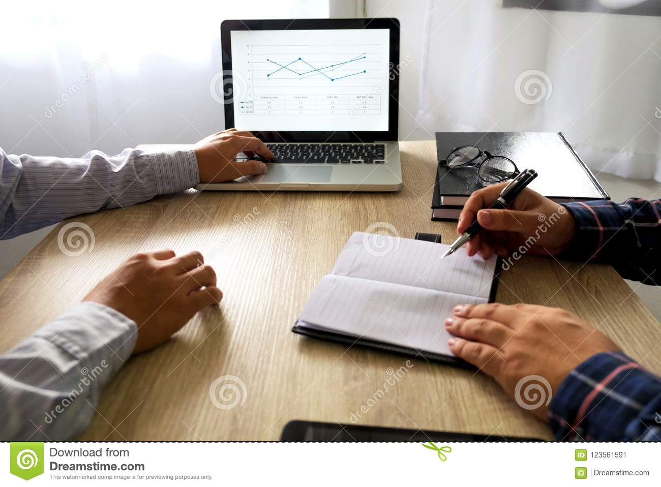 Businessman using laptop to teach and analysis the situation on