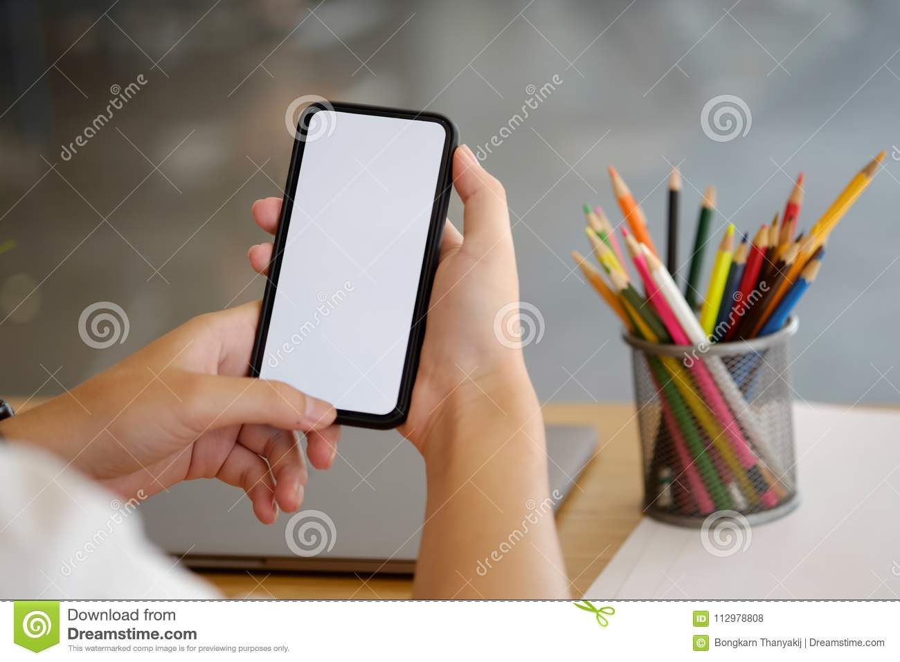 Man using mobile phone in office