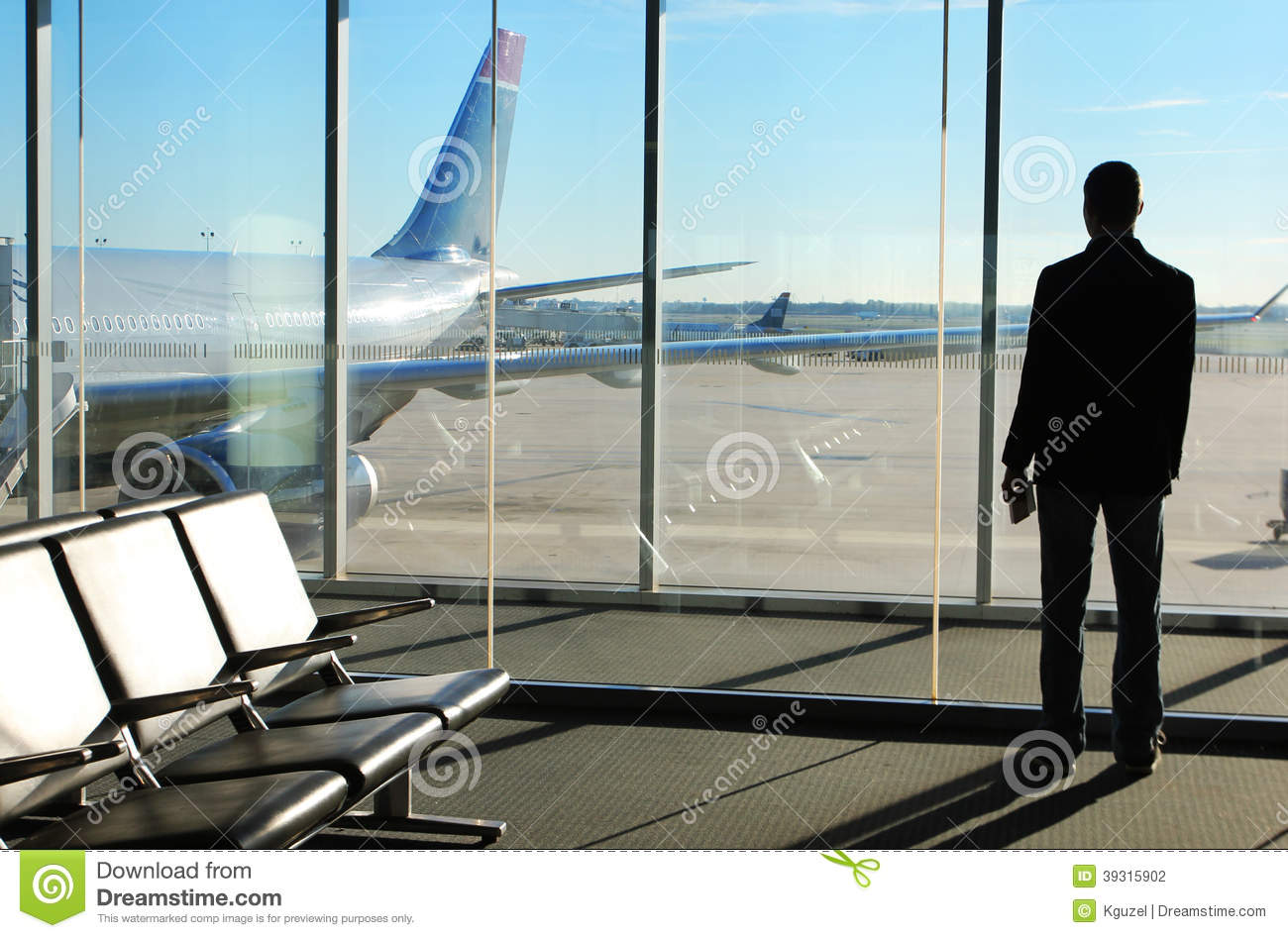 Businessman Waiting His Flight In Airport Stock Photo ...