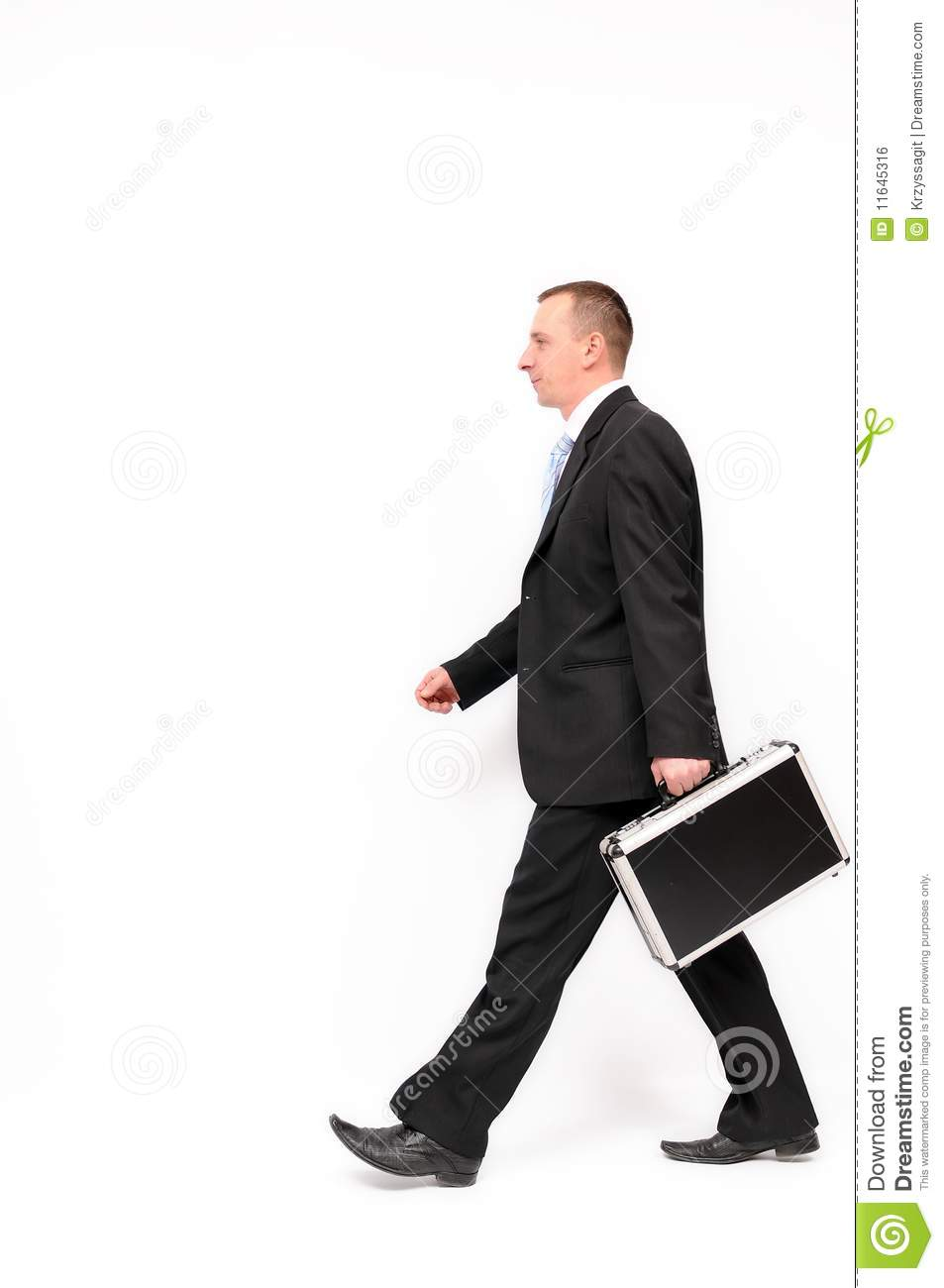 Young businessman walking with briefcase, isolated on a white ...
