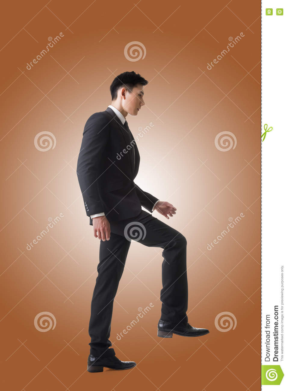 Businessman walking up on stairs