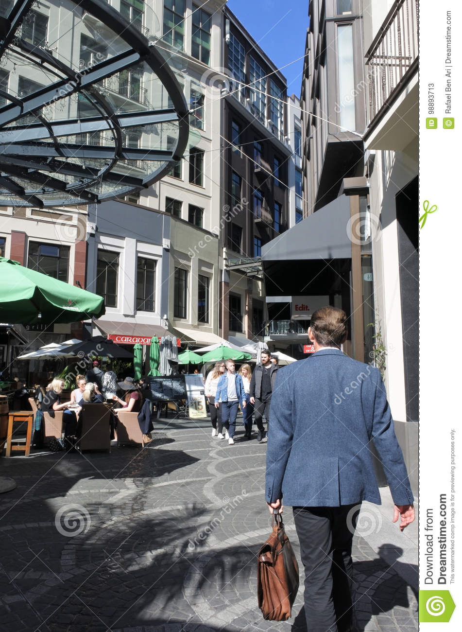 Businessman Walks In Chancery Square Auckland New Zealand Editorial