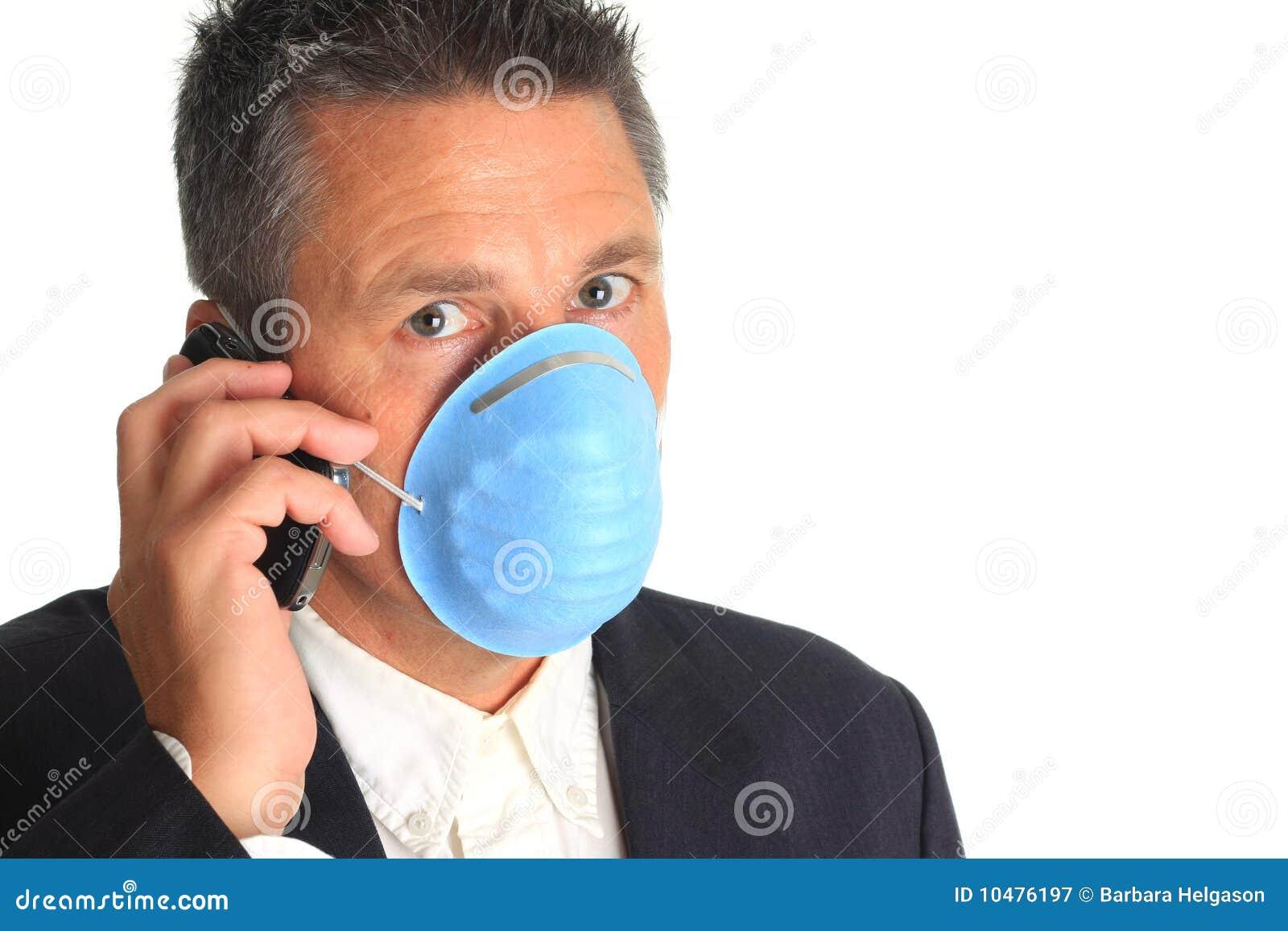 Businessman wearing a flu mask