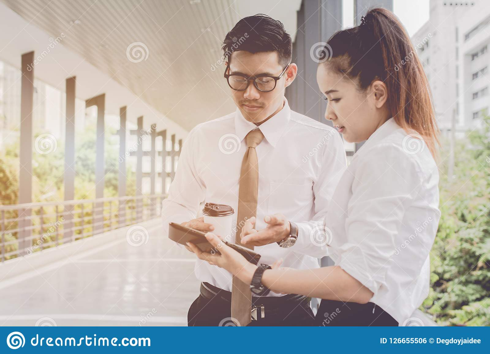 Businessman and woman using tablet of working. Meetings the commercial activities in promoting. Together create a mutually benefic