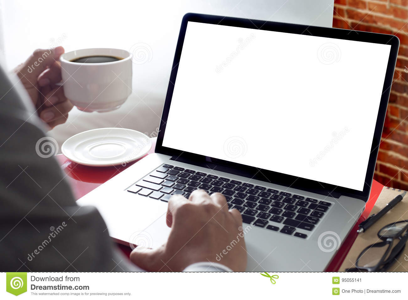 Businessman at work and computer at home Laptop with blank scre