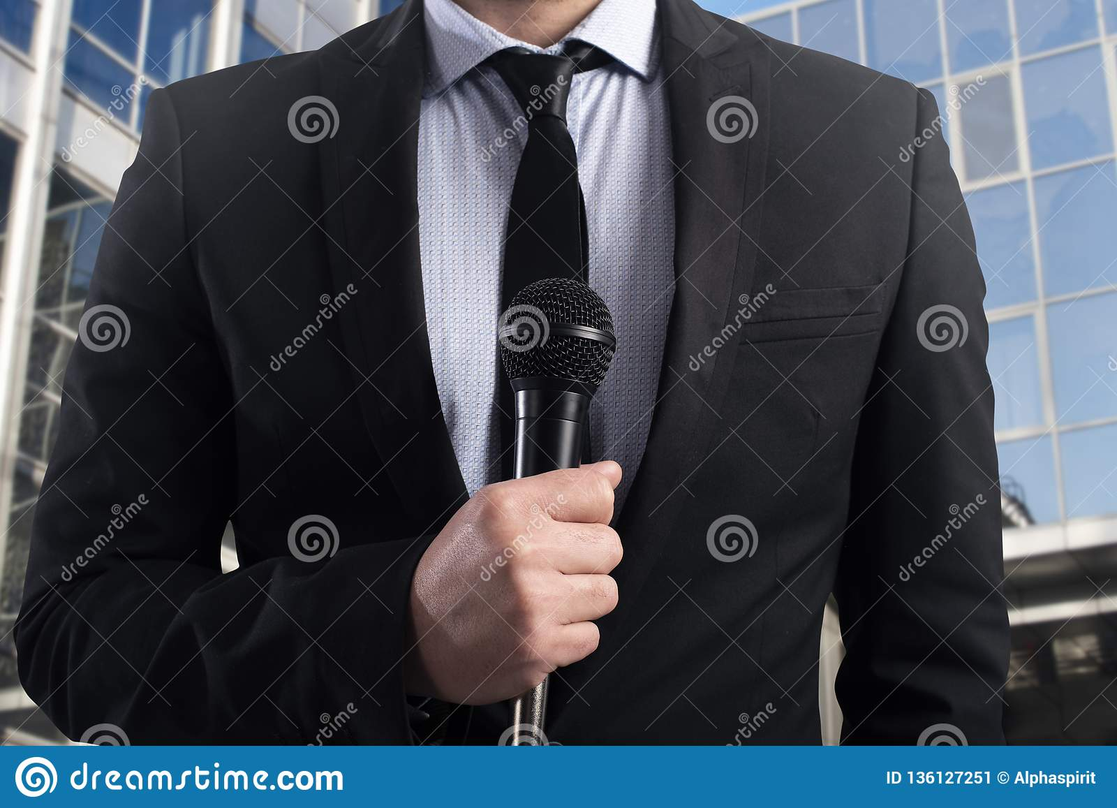 Elegant Businessman ready to speak with microphone